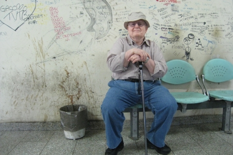 Padre-Resting-in-Italian-Bus-Station